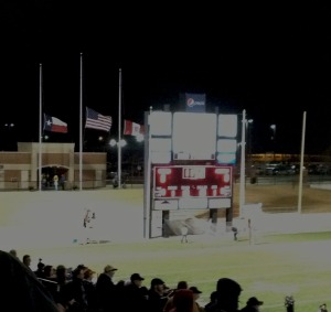 Flags fly at half staff at the Dec. 14 4A state semifinal Rider vs. Lancaster game at Northwest ISD Stadium following President Obama's directive after the Sandy Hook Elementary School shooting that left 26 students and faculty members dead.